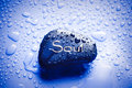 pisture of wet rock with the word soul on it